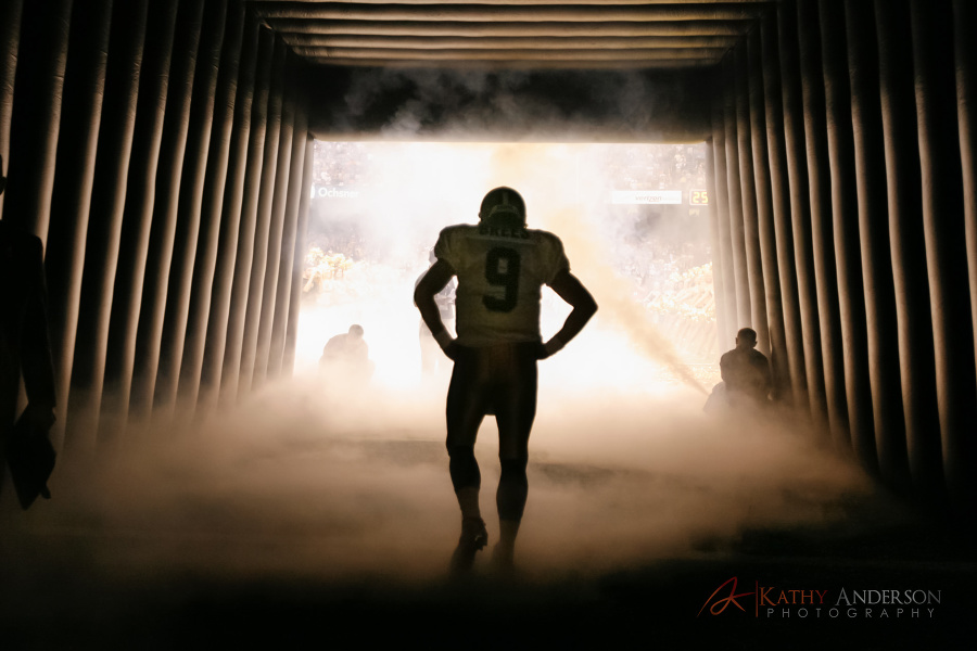 Quarterback Drew Brees of the New Orleans Saints walks onto the field in the Superdome.